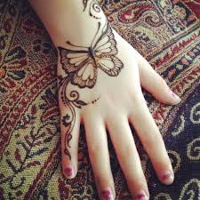 diagonal simple butterfly mehndi design for back butterfly