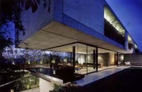 faux cantilever concrete house seems to float above glass