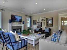 pretty blue and white coastal living room with grey sofa and beige