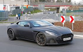 green aston martin db11 aston martin db11 s spied looking fierce autoguide com news