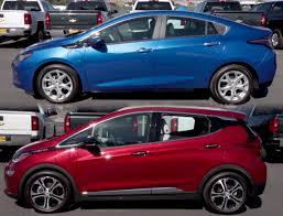 nissan leaf vs chevy volt dealership posts head to head comparison of chevrolet bolt volt