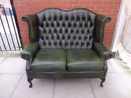green leather chesterfield sofa a dark green leather chesterfield queen ann two seater high back