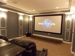 terrific home movie theater rooms with open high bookcase beside