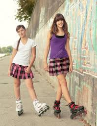 teenage girls on roller skates having fun u2014 stock photo prudkov