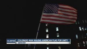 State Flag Of Colorado Colorado Man Waving American Flag For Unity Youtube
