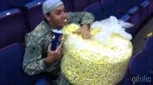 Meme Eating Popcorn - eating popcorn gif find share on giphy