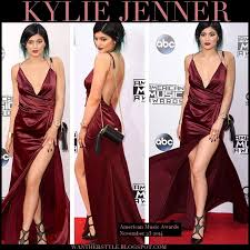 get the look kylie jenner in burgundy satin slit dress and black