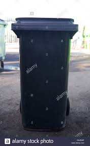 wheely stock photos wheely stock images alamy refuse collection in a black wheelie bin stock image