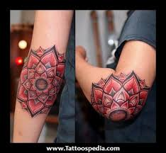 red black color scheme on flower mandala elbow tattoo