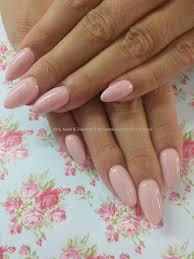 pastel pink gel polish over almond acrylic nails gel nail