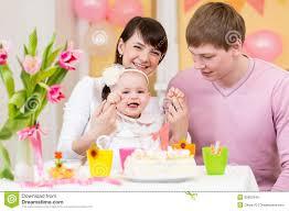 baby girl birthday family celebrating birthday of baby girl royalty free stock