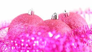 up of three pink tree balls rotate