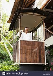 balinese man rides the funicular or tram at ubud hanging gardens