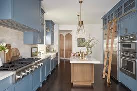 blue kitchen cabinets in cabin 20 charming cottage kitchens hgtv