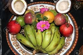 fruits flowers offering of fruits flowers and broken coconut shells to god