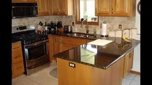 granite countertop honey oak kitchen cabinets wall color