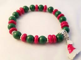 christmas beaded stretch bracelet with santa hat charm red green