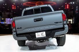 toyota trucks emblem toyota tacoma trd pro and 4x4 black painted emblem set oem