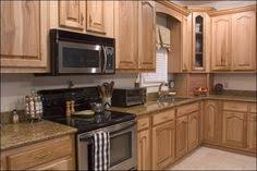 hickory cabinets with granite countertops dark granite hickory cupboards red floor kitchen ideas