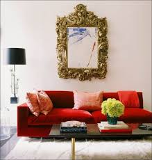 floor l with red shade antique gold mirror and red sofa with white rug for charming living