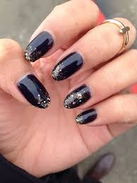 black gel manicure with gold glitter gradient on natural nails