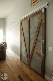 Sliding Barn Doors A Practical Solution For Large Or by Reclaimed Corrugated Metal Makes U201ctotally Bomb Proof U201d Exterior