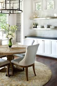 Cleaning A Wooden Dining Table by Rustic Wooden Table With Neutral Chairs And Clean White Cabinets