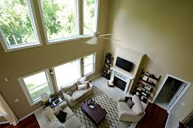 2 story living room two story wall molding decor and the dog