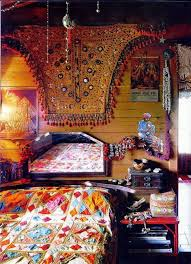 indian home bedroom decor with tapestry and mirror and bedding