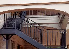 exterior stairs with large landing and custom rails rear porch