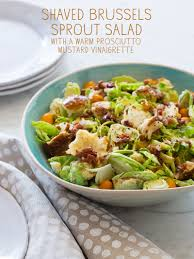 thanksgiving salad recipe shaved brussels sprouts salad salad recipe spoon fork bacon