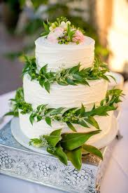 wedding cake greenery classic white wedding cake with leafy greenery