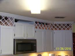 what to put on top of kitchen wall cabinets pin by kristin bernard on wine rack above kitchen cabinets
