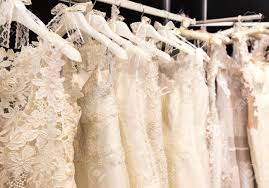 and white wedding dresses white wedding dresses hanging on shoulders and pegs stock photo