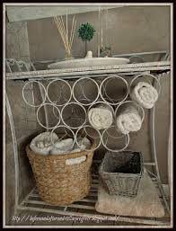 adorable white iron rack with rattan towel storage basket for