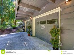 house exterior two car garage with driveway stock photo image