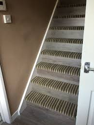 mixture of striped carpet and laminate stairs for a nice