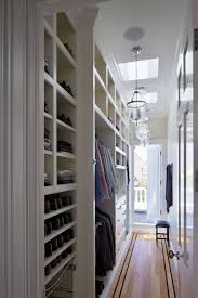 closet behind bed furniture small walk in closet design with crown molding and