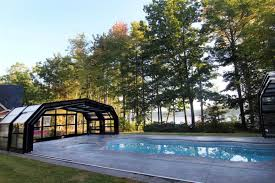 this amazing retractable roof shelters a pool in maine for year