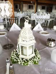 lovely lantern centerpiece finished with greenery u0026 baby u0027s breath