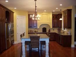 dark kitchen cabinets with dark wood floors square island in white