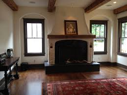 interior white wooden fireplace with black metal firebox