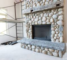 astounding river rock fireplace surround pics ideas tikspor