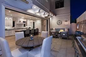 Round Brick Fire Pit Design - patio with white brick bench and white brick fire pit