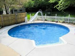 small inground swimming pools with round shape and slider board