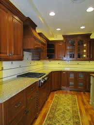 extensive brown white l shaped kitchen with pantry over long