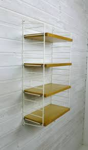 small ash wall shelving system by nisse strinning for string