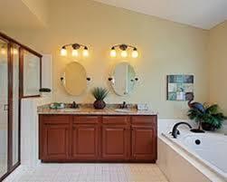 bronze mirror for bathroom bathroom vanity lights bronze mirror fabrizio design spruce up