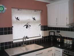 black and white roller blind over kitchen sink baileys blinds