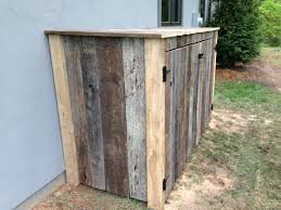 hiding trash cans using old barn wood british standard out